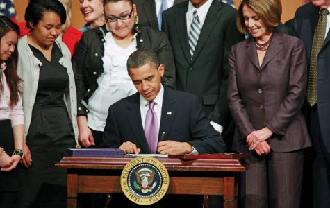 Promising decreased costs, President Obama signed sweeping health care legislation into law.