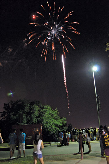 Festival+goers+watch+the+fireworks+display+at+the+2012+Hillfest.%0A