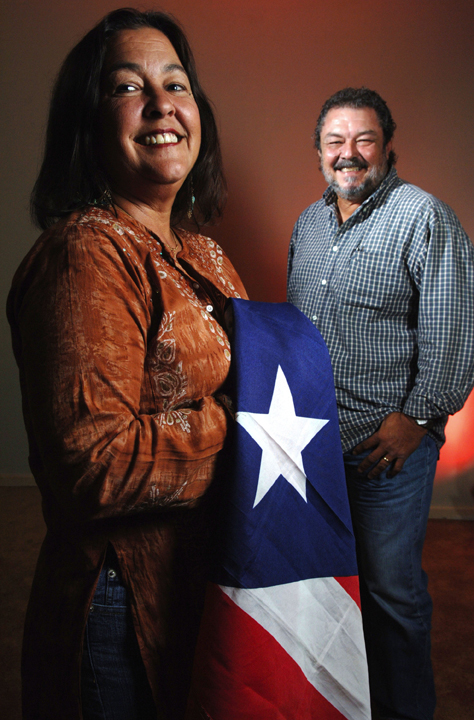 Puerto Rican natives Sonia Vizcarrondo-Rizarry and her husband Rafi Escudero-Miranda of Wellington, Florida, are on different sides of the Puerto Rico statehood debate, July 3, 2007. Sonia prefers commonwealth and Rafi prefers statehood.