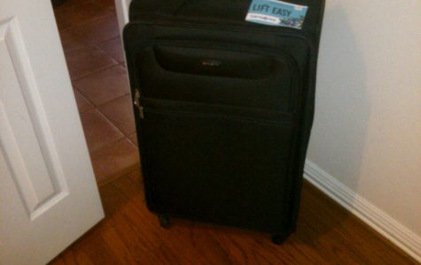 My empty suitcase stares longingly at me from the corner.