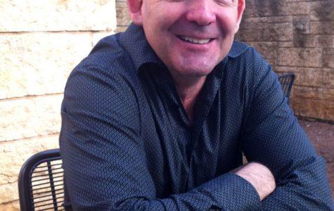 Professor translates life experiences to classroom teachings