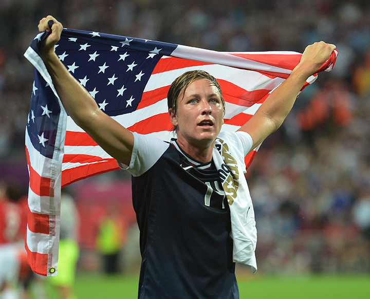 USA forward Abby Wambach celebrates with a U.S. flag following a 2-1 victory over Japan in the Olympics women's soccer final at Wembley Stadium in London, England, Thursday, August 9, 2012.