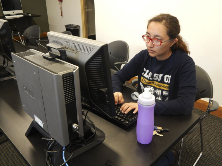 Janie Coronado sits in one of the computer labs experiencing printer problems on campus.