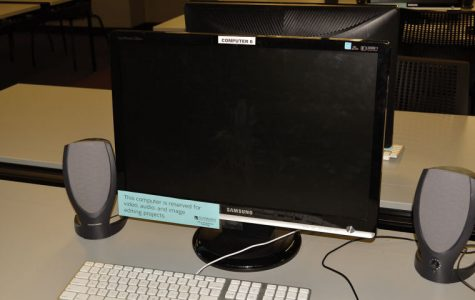 The media center has computers reserved for specific projects.