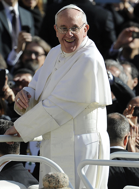 Pope Francis waves to the crowd from the Popemobile during his inauguration mass at St Peter's square on March 19, 2013 at the Vatican.