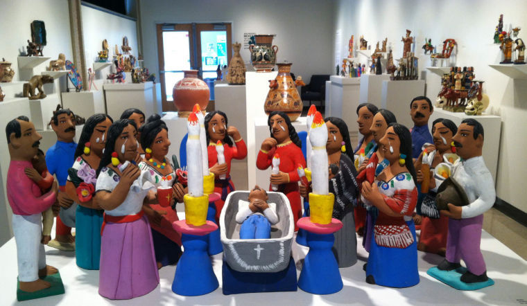 The exhibit features a wide variety of sculptural Mexican folk art from different time periods.
