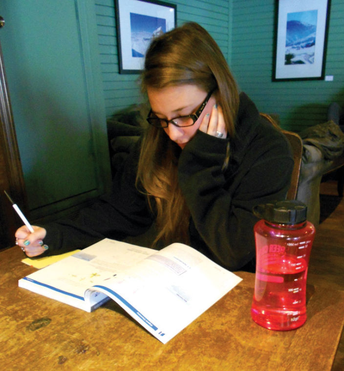 December graduate and aspiring medical student Nicole Wellman studies at a local coffee shop.