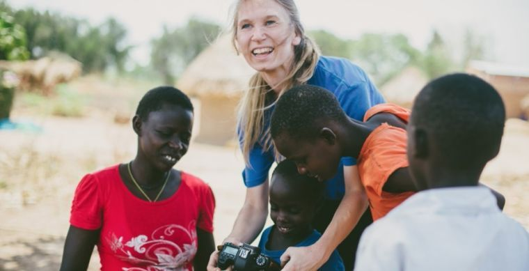 Smiles and little hands surround Jameson while in Uganda.
