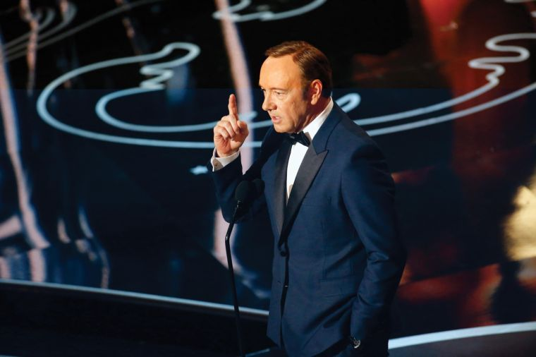 Kevin Spacey on stage during the 86th annual Academy Awards on Sunday, March 2, 2014, at the Dolby Theatre at Hollywood & Highland Center in Los Angeles.