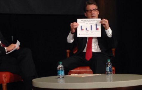 Texas Gov. Rick Perry holds up a chart explaining where jobs have been created by level of wages.