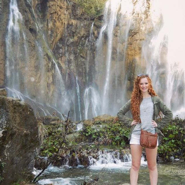 Standing below the final waterfall at the Plitvice Lakes National Park, Croatia.