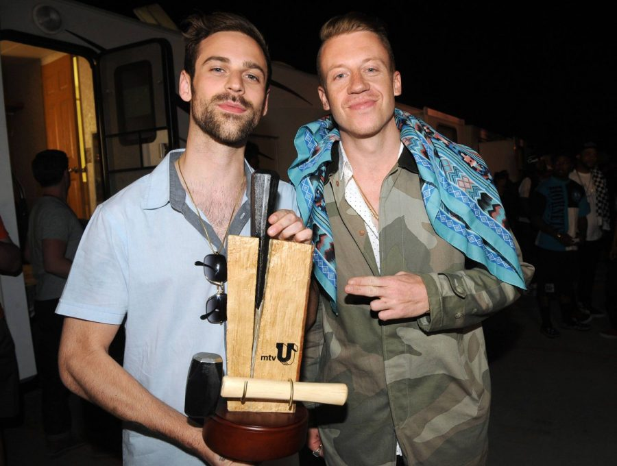 Ryan Lewis, left, and Macklemore pose backstage with the Branching Out Woodie at the mtvU Woodie Awards on Thursday, March 14, 2013, in Austin, Texas.
