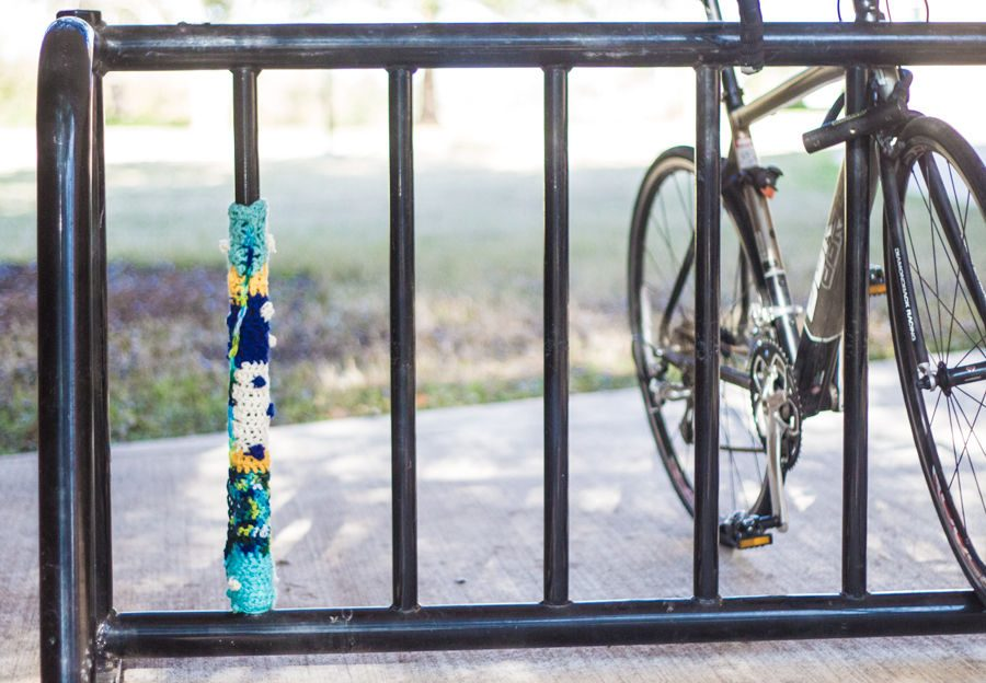A crochet form of graffiti created around one of the universities bike racks.