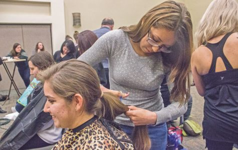 Students donate hair, shave heads for Colleges Against Cancer event