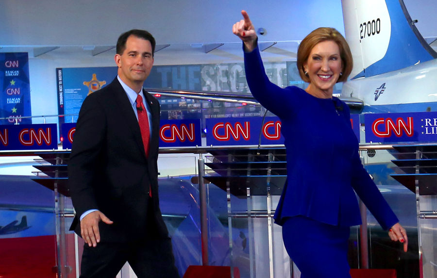 Former HP CEO Carly Fiorina, right, won the debate, according to a new Hilltop Views poll. Wisconsin Gov. Scott Walker walked out of the presidential race on Monday.