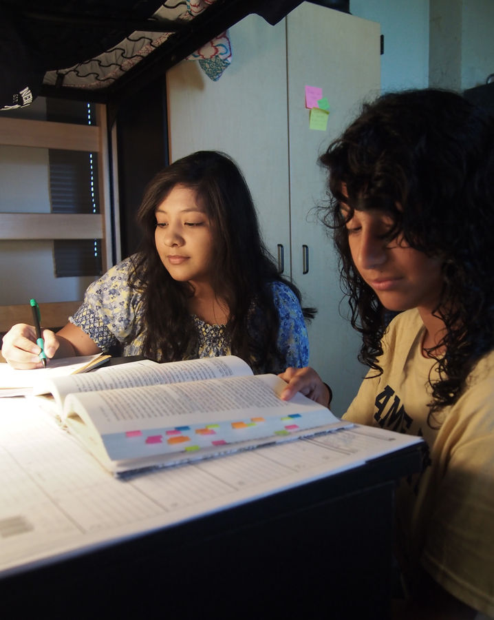 Sophomore Magaly Vargas, left, and freshman Isabel Martinez study inside a friend's room in Johnson Hall. The Village was built in 2009; it is currently the newest residence hall.