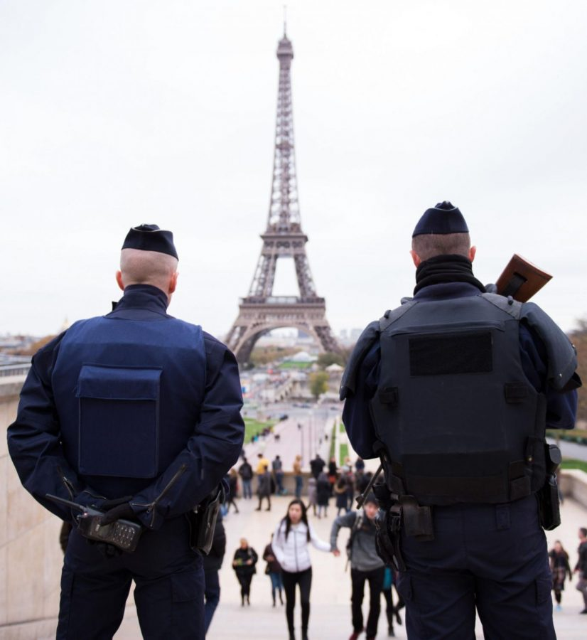 Police+officers+patrol+at+Place+du+Trocadero+near+the+Eiffel+Tower+on+Nov.+14%2C+2015+in+Paris%2C+France.+At+least+120+people+were+killed+in+a+series+of+terrorist+attacks+in+Paris.