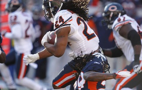 Chicago Bears running back Marion Barber (24) runs past Denver Broncos defensive back Jonathan Wilhite (29) during the first half of their game at Mile High Stadium in Denver, Colorado, on Sunday, December 11, 2011. (Nuccio DiNuzzo/Chicago Tribune/MCT)