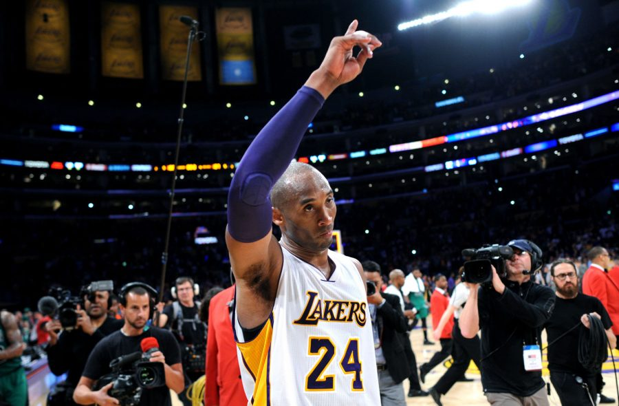 The Los Angeles Lakers' Kobe Bryant waves to the crowd as he leaves the court following a 107-100 loss against the Boston Celtics at Staples Center in Los Angeles on Sunday, April 3, 2016. (Wally Skalij/Los Angeles Times/TNS)