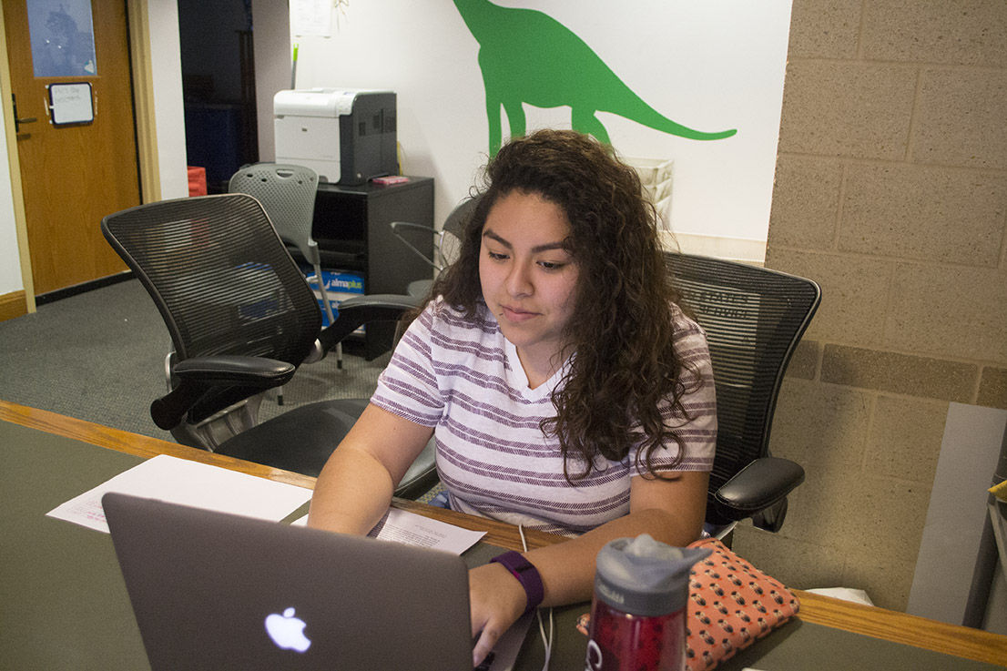 Junior Nixi Cruz-Sanchez, a desk worker, is one of many students that could be affected by the student employment policy that limits a work week to 20 hours.