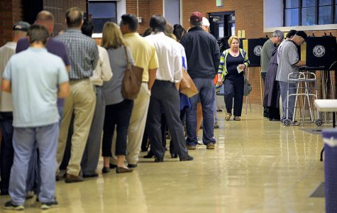 Voters line up at the polling site at Paschal High School in Fort Worth, Texas, on Tuesday, Nov. 4, 2014.