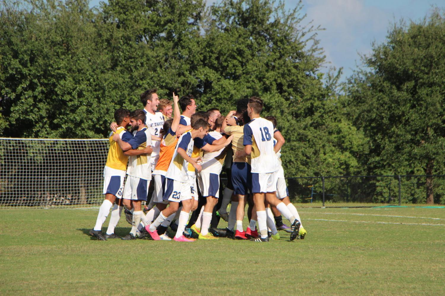 The St. Edward's men's soccer team celebrates its first NCAA Tournament victory in program history on Nov. 12.