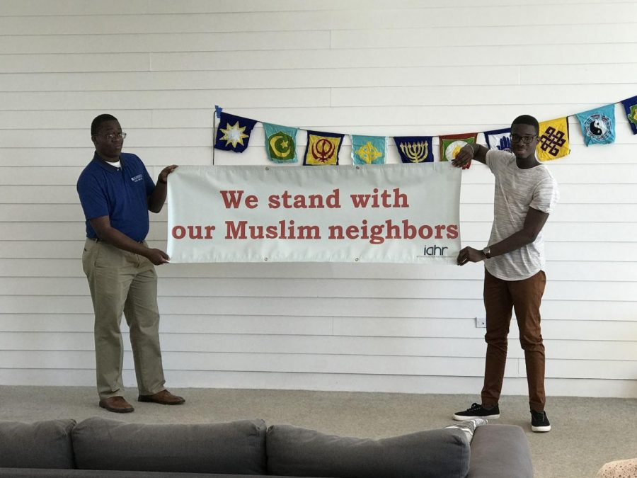 Jonathan Edwards (left) and Abraham Bassam (right) unveiled ILC's banner at the social.