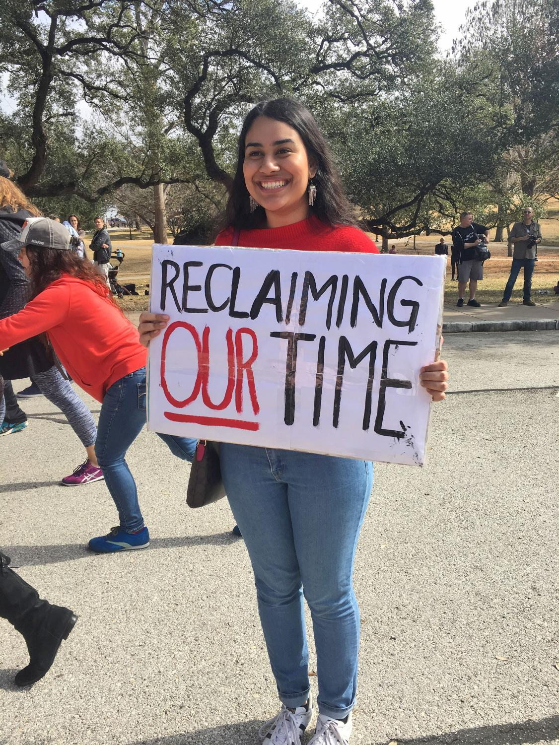 A young woman protests agains White Supremacy at the Capital.