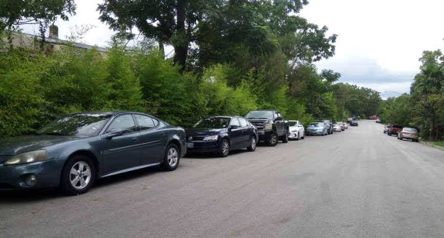 Students have opted to park on streets near the university rather than pay for a parking pass.