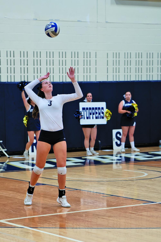 Melissa McNeil serves against Texas A&M International University.