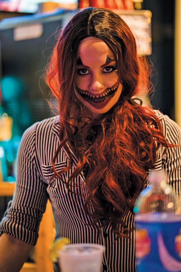 A+spooky+clown+enjoys+her+night+on+6th+street.