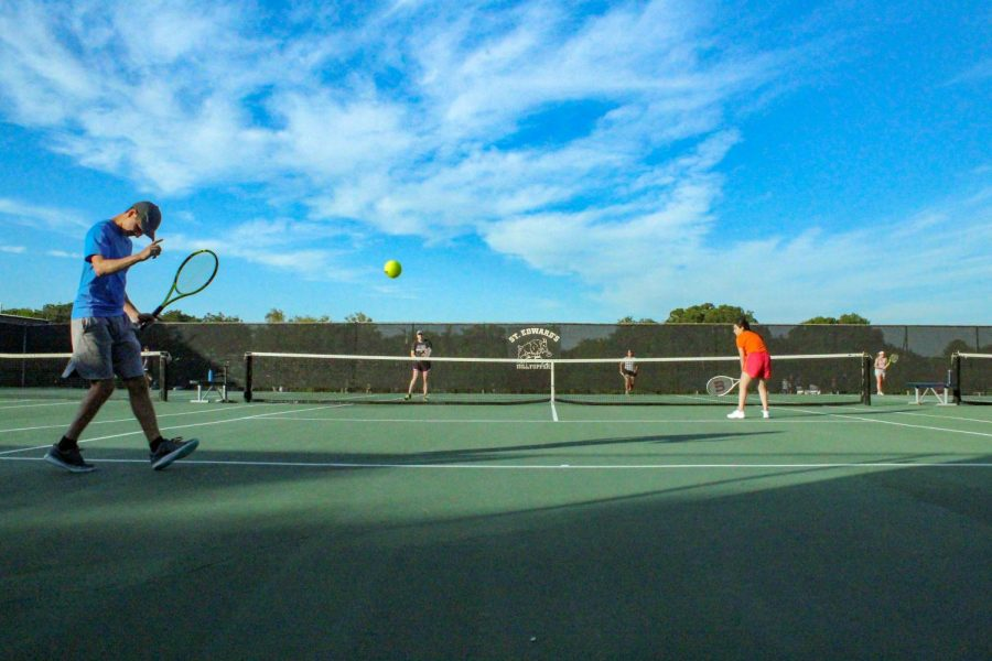 Club tennis practices for upcoming tournaments.