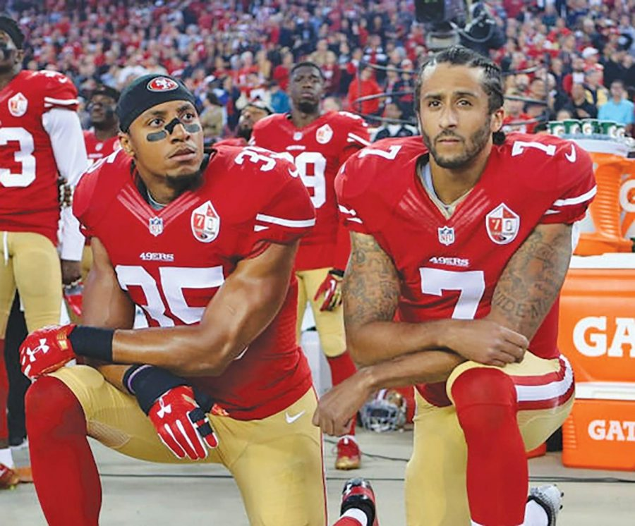 Eric+Reed+%28left%29+and+Colin+Kaepernick+%28right%29+both+make+a+bold+statement+by+kneeling+for+National+Anthem+before+an+NFL+game.