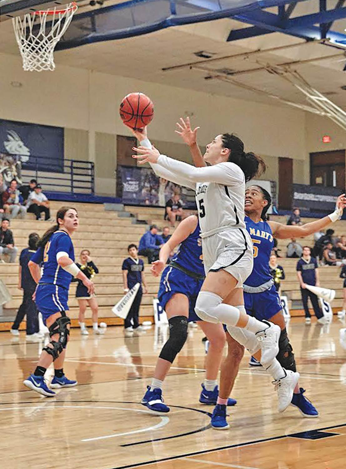 Isabel Hernandez' career-high 39 points helps lead to Coach Riehl's 100th career win.