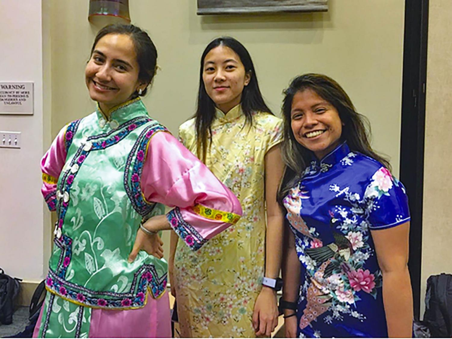 SEU students pose in traditional Chinese cheongsams.