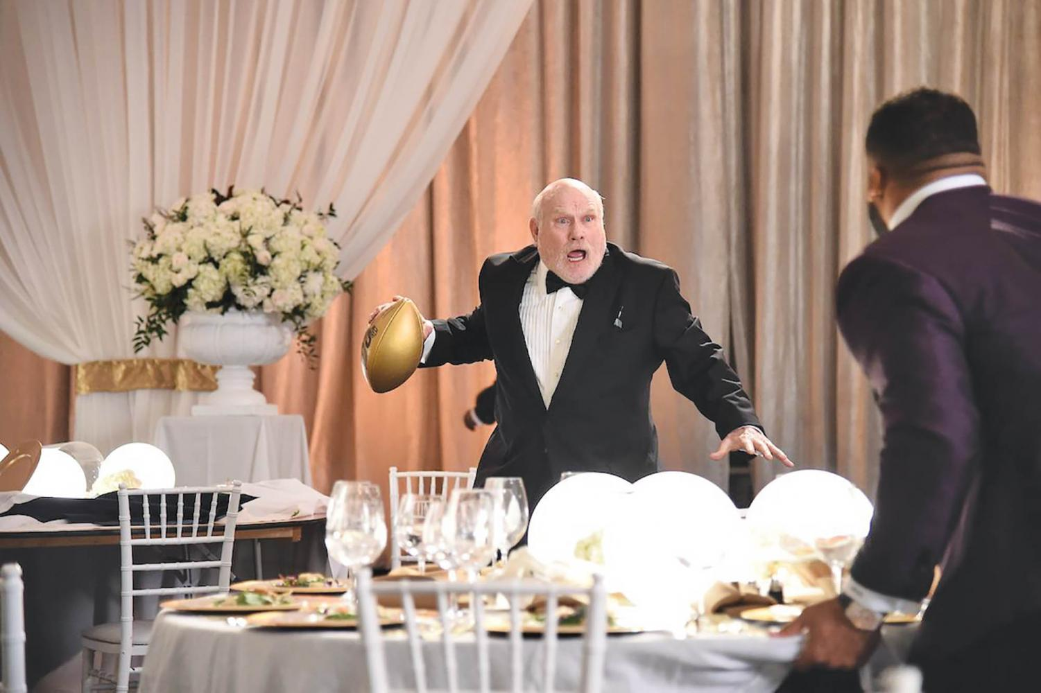 Terry Bradshaw prepares a pass to another NFL legend.