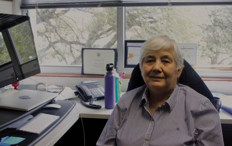 Professor Anna Escamilla sits in her office in Doyle Hall. She plans to retire at the end of the academic year.