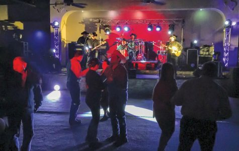 Attendees dance the night away as musician David Farias performs.