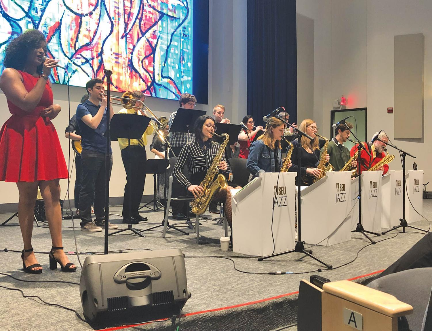 Sierra Bouldin (left) sings with fellow members of the SEU  Steady Band. All three groups will preform again in April in Jones Auditorium.