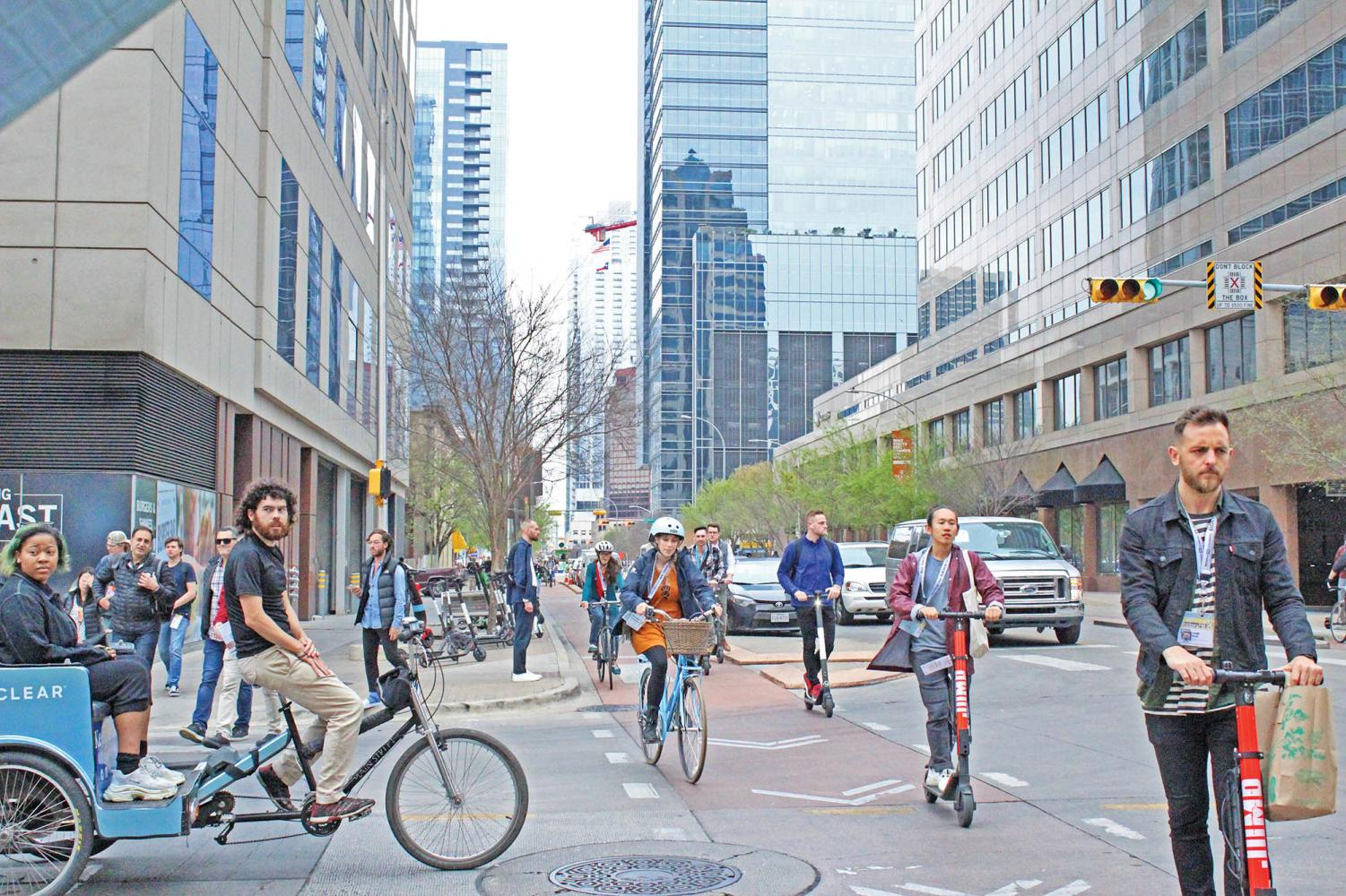 people ride the rentable scooters down 3rd street. The city has become overloaded with dockless mobility scooters, with almost 5,000 in the greater austin area alone