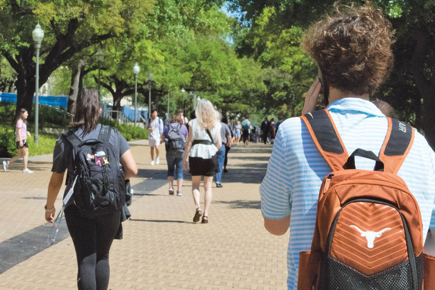 Students make their way to class on UT's crowded campus.