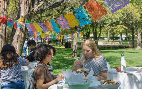 Students crowd around vendor and food tables to celebrate  with their peers. A few dishes provided included coquetas, empanadas, tequenos and ceviche.