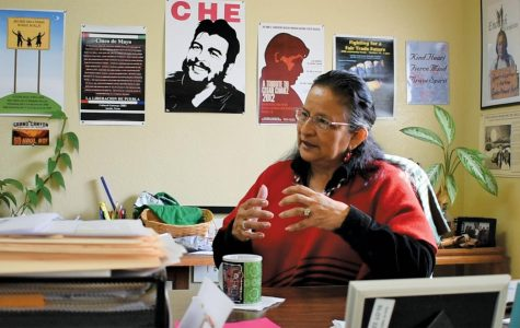 Almanza, the leader of PODER, sits in her East Austin office. Almanza has been an environmental activist for over 20 years.