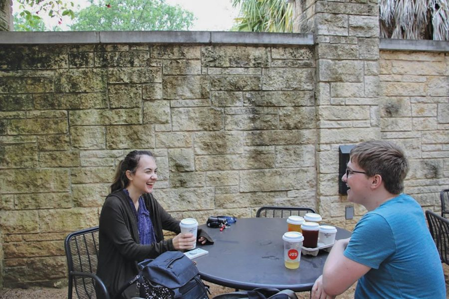 St. Edward's students Victoria Applewhite and Brian Mack enjoy each other's company over a cup of Jo's coffee.