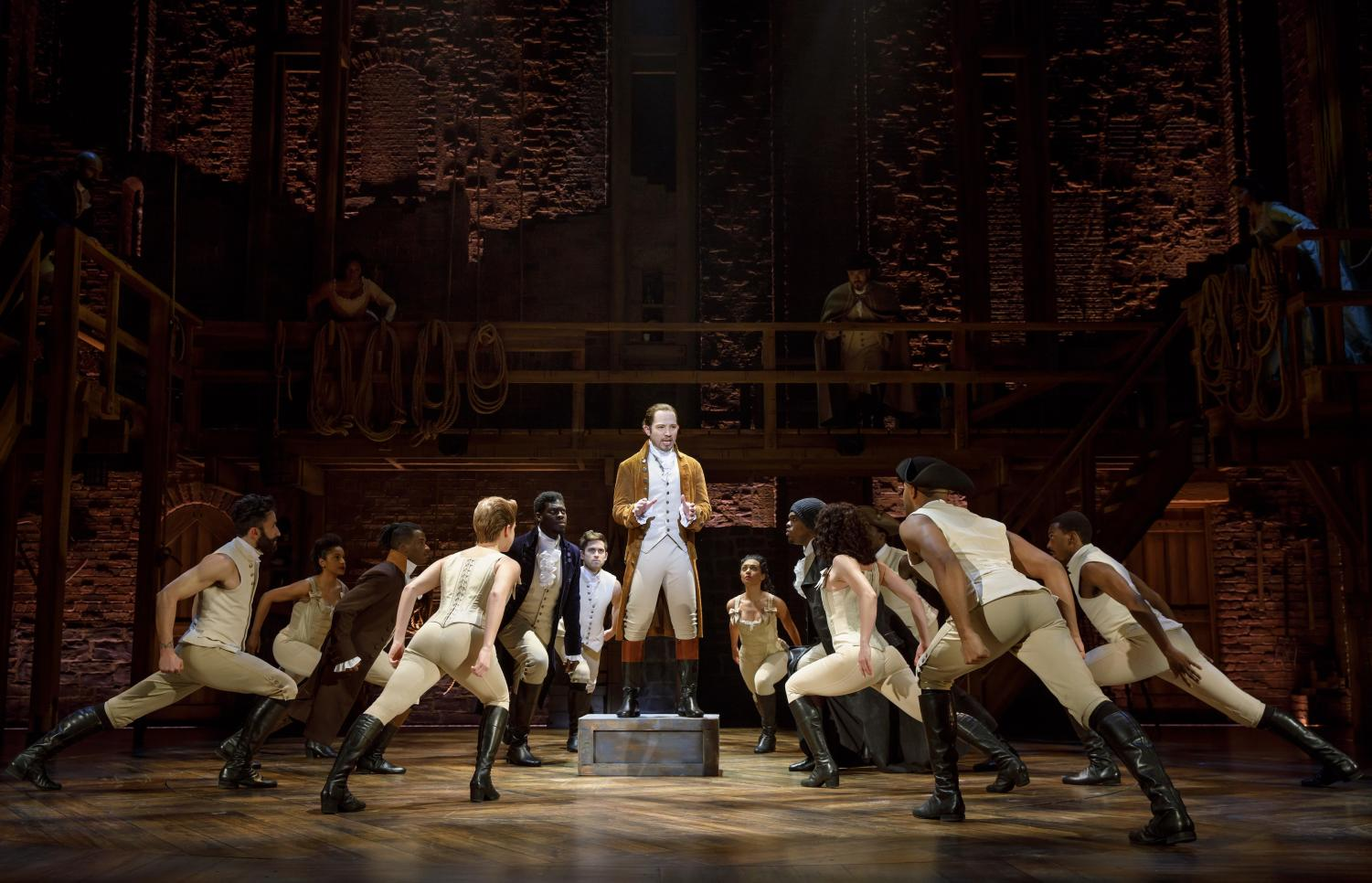 The company of Hamilton and Joseph Morales performing on stage. The show is currently being performed at Bass Music Hall in Austin.