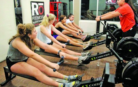 Rowing club president Jo Sanchez instructs fellow teammates on the proper rowing mechanics.