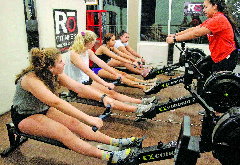Rowing club president Jo Sanchez instructs fellow teammates on the proper rowing mechanics.