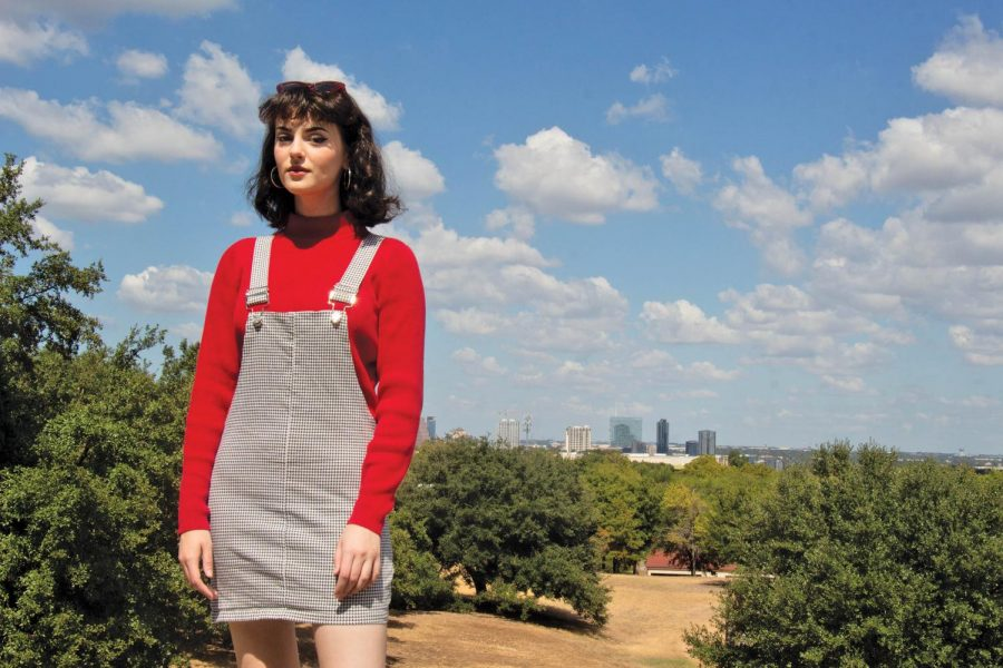 Allison Smith poses out by Main Building with the Austin skyline as her backdrop. Smith pulls style inspiration from famous rock stars and musicians.