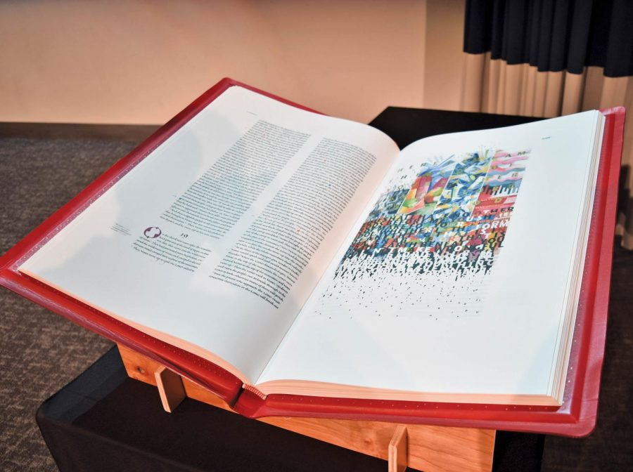 The+Saint+John%27s+Bible+is+a+hand+illuminated+and+illustrated+text.+It+is+currently+on+display+in+the+Munday+Library.