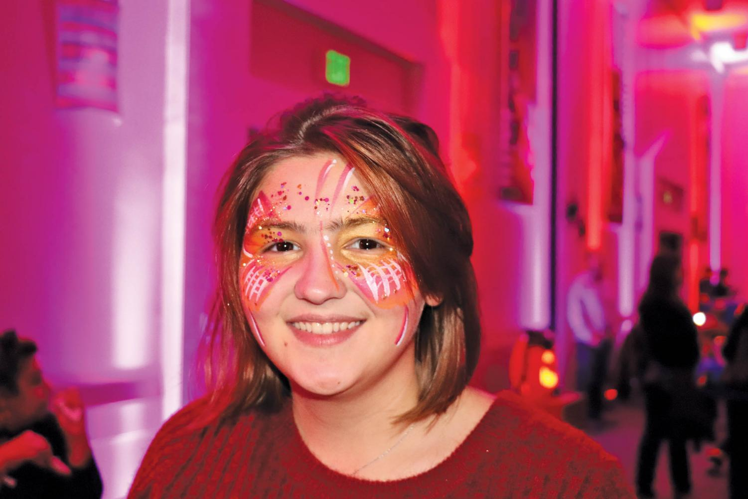 Hailey Beuhler shows off her face paint that she got at the event. Halloscream offered other festive activities including magic wand building, cape making and cookie decorating to help get visitors into the holiday mood.